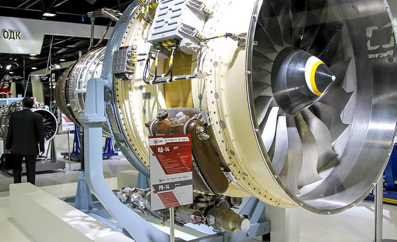 Двигательная установка ПД-14 с изготовленными из полимерных композиционных материалов узлом мотогондолы, панели газогенератора, решетки реверсивного устройства и др.