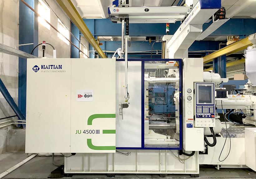 Термопластавтомат с манипулятором выгрузки полимерных фитингов для труб на заводе  «ПК КОНТУР»