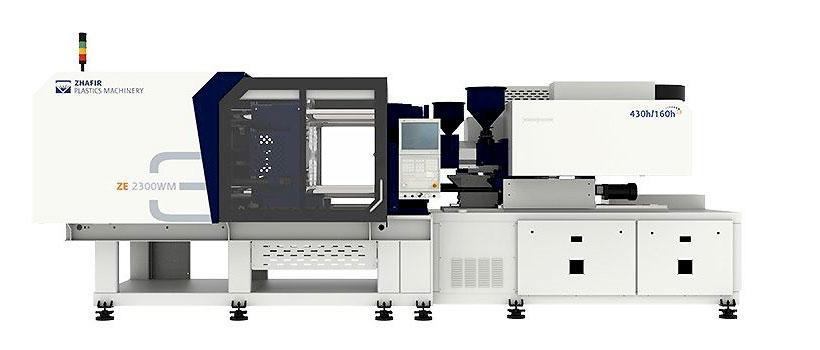 Термопластавтомат ZHAFIR серии Zeres WM модель ZE2300WM-300/160 на которой установлена 2-х гнездная пресс-форма для литья чашки из жидкого силиконового каучука